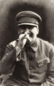 Joseph Stalin making a face at his bodyguard.