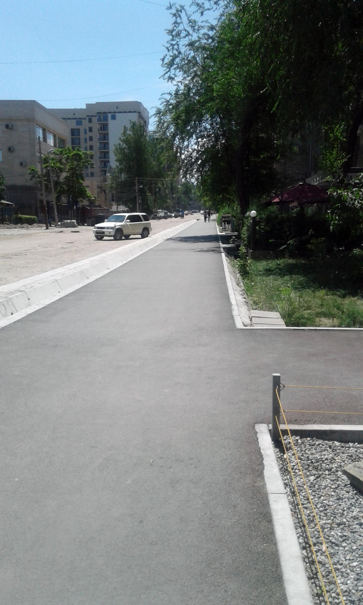 A newly laid asphalt footpath